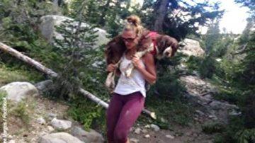 她勇扛25公斤傷狗走20里下山 如得神助收獲連連